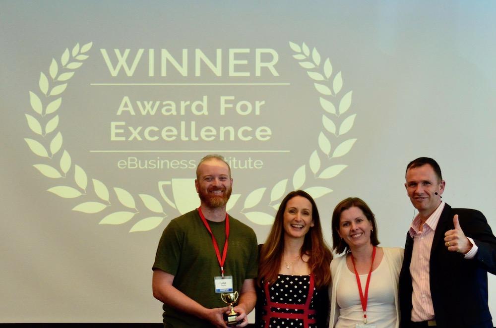 Luke Tourish and Leah Tourish winning digital marketing award from Matt Raad and Liz Raad