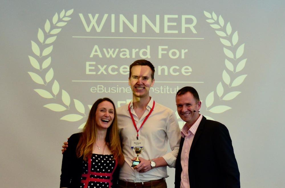 Richard Perrin winning digital marketing award from Matt Raad and Liz Raad