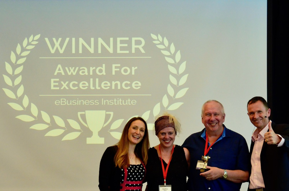 Robert Rushford and Kathie Baker winning digital marketing award from Matt Raad and Liz Raad